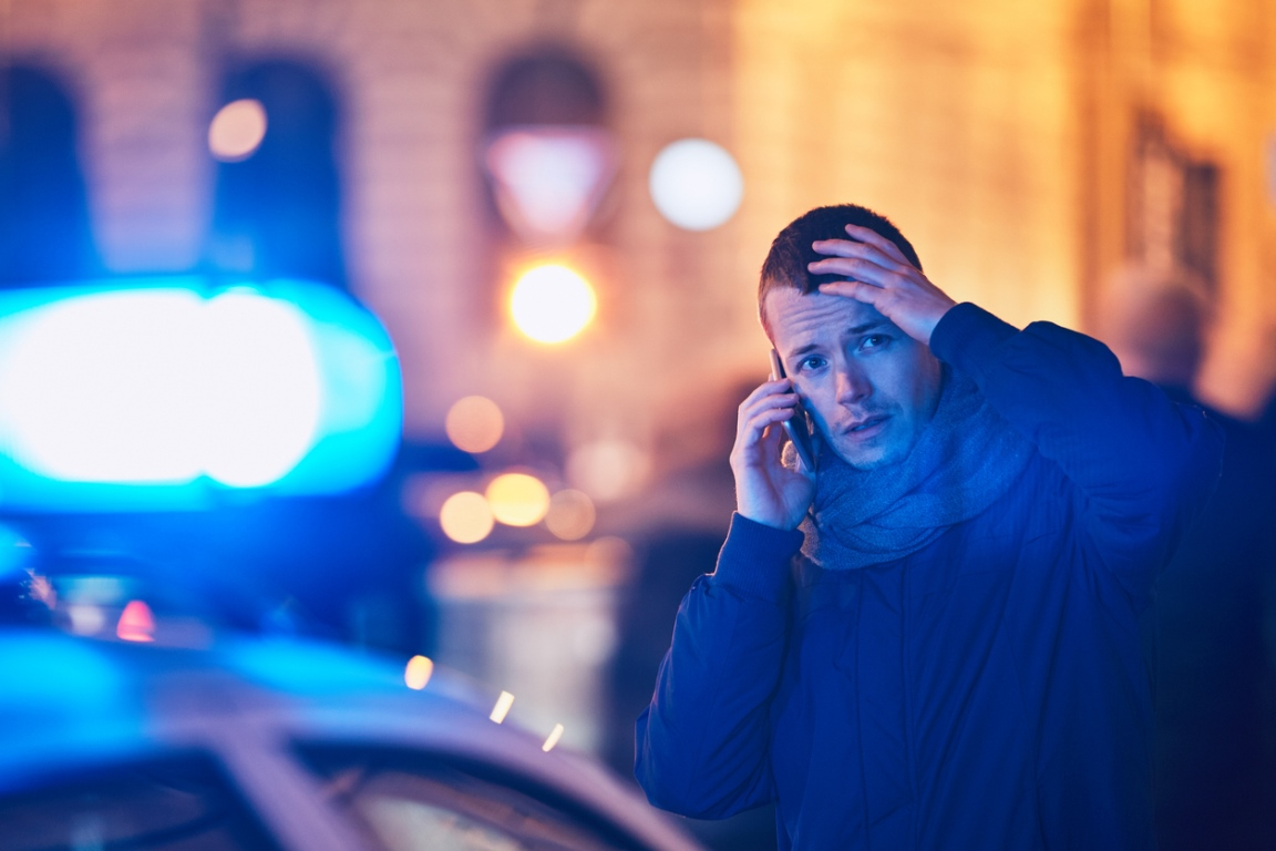 Person making an urgent call following an accident